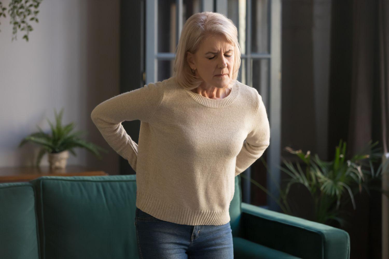 Der Schmerz des Bauches und des Rückens bei der Schwangerschaft